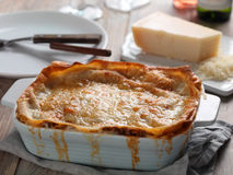 Lasagna Bolognese on a rustic table Royalty Free Stock Image