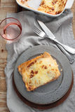 Lasagna Bolognese on a rustic table Stock Images