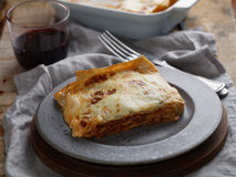 Lasagna Bolognese on a rustic table Royalty Free Stock Photography