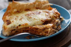 Lasagna Bolognese on a rustic table Stock Photo