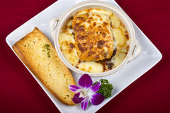 Lasagna with bread Stock Images