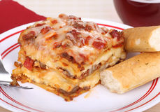 Lasagna and Bread Sticks Stock Photography