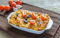 Lasagna with cherry tomatoes Royalty Free Stock Images