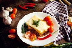 Lasagna with chilli pepper Stock Images