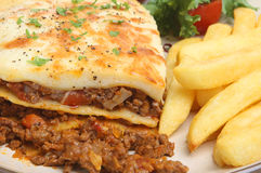 Lasagna & Chips. Beef lasagna served with chips and salad Stock Photography