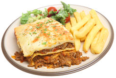 Lasagna and Chips. Beef lasagna served with chips and salad Royalty Free Stock Photo