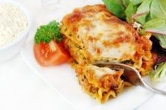 Lasagna con la ensalada Foto de archivo libre de regalías