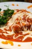 Lasagna cubierto en salsa y queso Fotos de archivo libres de regalías