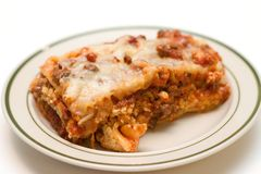 Lasagna Dish. Piece of lasagna on a simple dish Royalty Free Stock Photography