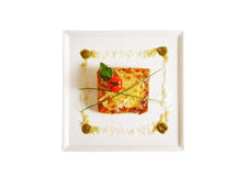 Lasagna on dish isolated on white Royalty Free Stock Photos