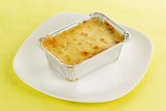Lasagna in foil box Stock Photos