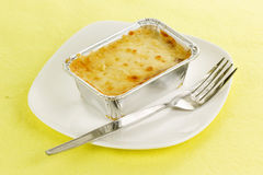 Lasagna in foil box Royalty Free Stock Photography