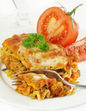 Lasagna Fork In Tomato Half Royalty Free Stock Photography