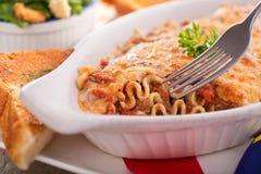 Lasagna. A freshly baked homemade lasagna with garlic bread and caesar salad royalty free stock photo