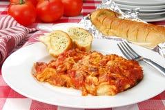 Lasagna and garlic bread Stock Images