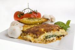 Lasagna and garlic bread Royalty Free Stock Image