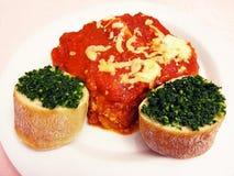 Lasagna With Garlic Bread Royalty Free Stock Images