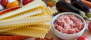 Lasagna ingridients. On wooden table stock photo