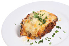 Lasagna or Lasagne Meal. Beef lasagne topped with freshly grated Parmesan cheese and chopped parsley Royalty Free Stock Photo