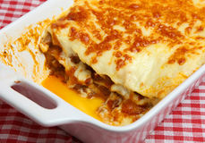 Lasagna or lasagne in Serving Dish. Freshly baked beef lasagna in white ceramic casserole dish Royalty Free Stock Images
