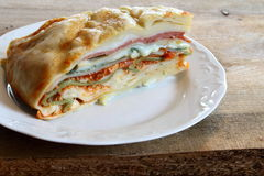 Lasagna with meat sauce, salami, spinach and alfredo sauce. Lasagna with meat sauce, salami, spinach and alfredo sauce on a white plate Stock Images