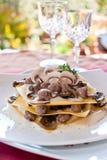 Lasagna med champinjonen på en restaurang Fotografering för Bildbyråer