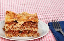 Lasagna with napkin and fork Royalty Free Stock Photography
