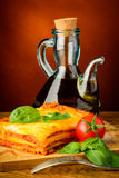 Lasagna and olive oil Royalty Free Stock Photography
