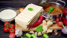 Lasagna pasta sheets, bolognese and bechamel sauce. LRecipe of lasagna - pasta sheets, bolognese and bechamel sauce on wooden table stock video footage