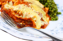 Lasagna and peas Stock Photography