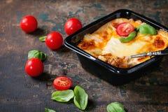 Lasagna in plastic box Stock Photos