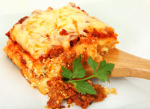 Lasagna Portion on Serving Spoon Stock Image