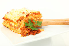 Lasagna Portion on Serving Spoon Royalty Free Stock Photo