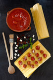 Lasagna Preparation. Some of ingredients and kitchen utensils used to prepare lasagna following an old recipe from Naples: lasagna sheets, small meatballs in Royalty Free Stock Photography