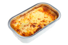Lasagna Ready Meal. Freshly baked Lasagna convenience meal in a foil container Stock Image