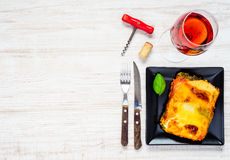 Lasagna with Rose Wine on Copy Space royalty free stock photography