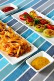 Lasagna's met vlees en geroosterde groenten stock afbeeldingen