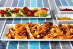Lasagna's met vlees en geroosterde groenten royalty-vrije stock foto's