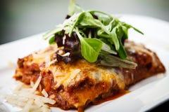 Lasagna with salad Royalty Free Stock Photography
