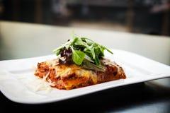 Lasagna with salad Stock Photos
