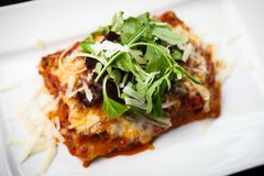 Lasagna with salad Stock Photo