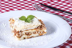 Lasagna served on a white plate Royalty Free Stock Photography