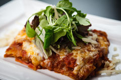Lasagna with salad Royalty Free Stock Images