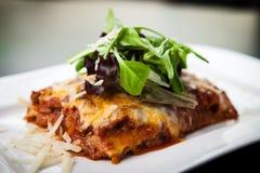Lasagna with salad Royalty Free Stock Photos