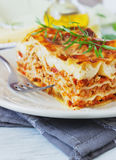 Lasagna. Serving freshly cooked lasagna on a dining table close up. italian cuisine Stock Images