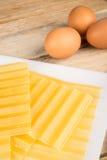 Lasagna sheets and eggs Stock Photos