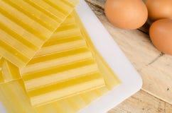 Lasagna sheets and eggs Royalty Free Stock Photos