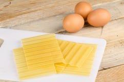 Lasagna sheets and eggs Stock Photography