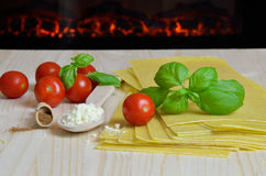 Lasagna sheets and fireplace Stock Images