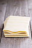 Lasagna sheets stacked on table Royalty Free Stock Images